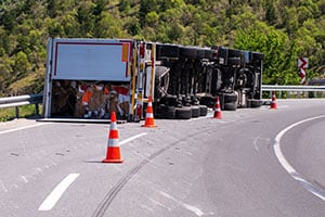 Truck tipped over on road