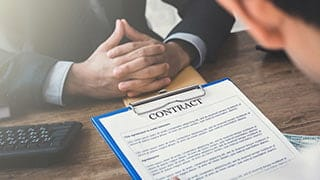 Employee reviewing contract with manager